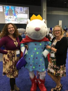 photo of two attendees with mouse character